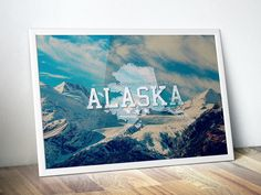 """Alaska! Show your state pride with this original art print that celebrates the beauty of Alaska and proudly displays the AK state slogan """"Beyond your dreams, within your reach"""" and has a vintage distressed feel. Flaunt your home state in style on your bedroom, dorm or study wall and let everyon #LandscapePhotography #WallArt #HomeDecor #GiftIdea #CanvasArtPrint #BirthdayGift"""