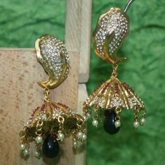 Polki work jhumki studded with stone and AD
