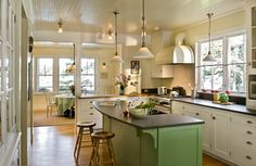 white kitchen, wood floors and black counters