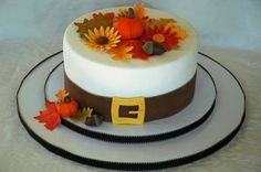 Thanksgiving Cake with Pilgrim's belt and fall floral