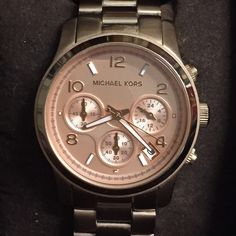 Authentic Michael Kors Runway Watch ⚡️FINAL PRICE⚡️Rose gold watch.minor wear on links closest to the clasp. See pic # 3 z Price reflects this. needs battery. Stored in original box with  2 links that were removed. Image is from the Internet. Michael Kors Jewelry