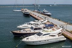 """Download the royalty-free photo """"Motor boats at the pier on the sea"""" created by ksene at the lowest price on Fotolia.com. Browse our cheap image bank online to find the perfect stock photo for your marketing projects!"""