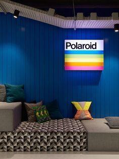 Lit up vintage Polaroid sign in colorful lounge area