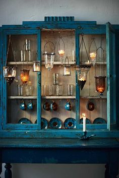 blue / gold / antique / lights / cabinet / tea cups
