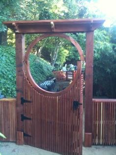 An incredibly beautiful custom-built moon gate with an Asian-inspired gate latch to top it off. Gate builder Sean Hennick of the San Francisco Bay Area. Phone: