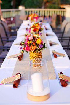 A Caribbean themed table scape with Pineapple Centerpieces via APinchofLovely.com.