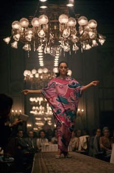 Runway model shows off gown made of Como silk in Belagio, Italy, July 1968.  Photograph by Joe Scherschel, National Geographic