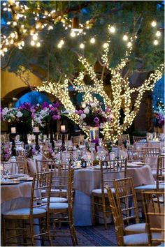 Wrap tree trunks or venue pillars with lights to provide a glow during wedding receptions
