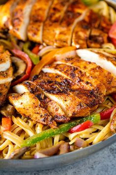 Creamy Cajun Chicken Pasta is the perfect family meal.Juicy cajun-spiced chicken is served over a bed of creamy linguinethat's packed full of sautéed veggies.