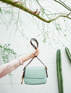 The prettiest new shade for spring is seaglass and the Harper Crossbody handbag in seaglass is our go-to bag for the season. @erinloechner