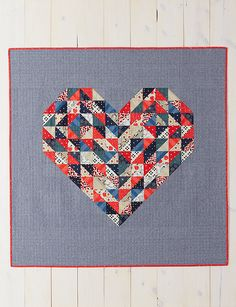 Hearts on Fire Quilt: Decorate her dorm room with a fat quarter-friendly quilt that you can make in a few days or less. Find this pattern and more in Weekend Quilting: Quilt and Unwind with Simple Designs to Sew in No Time by Jemima Flendt. Heart Quilt Pattern, Quilt Patterns, Scrappy Quilts, Mini Quilts, Fat Quarter Quilt, Half Square Triangle Quilts, Textiles, Book Quilt, Antique Quilts