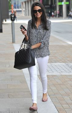 No room for error: Michelle Keegan couldn't stop smiling as she headed out in Manchester w...