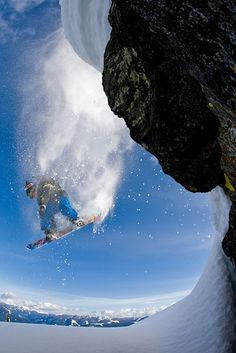 Snowboarder Travis Rice flies off a cliff in the Kootenay Mountains, British Columbia, Canada, while making The Art of Flight, which brought terrain park tricks to big-mountain descents around the world. Snowboards, Travis Rice, The Art Of Flight, Big Mountain, Rare Pictures, Ski And Snowboard, Outdoor Fun, Outdoor Activities, Cool Photos