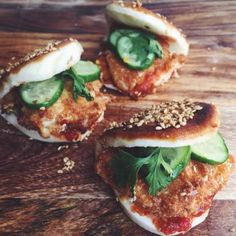 Spicy Chicken Katsu Toasted Sesame Steamed Buns: Chicken Katsu Steamed Buns with pickles, cilantro and chili paste