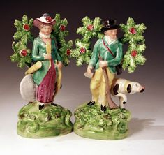 Pair of Staffordshire pottery figures of an archer and sportsman ...