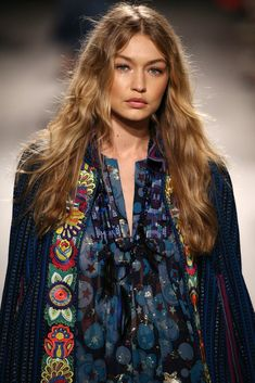 """The Cut: long, varied lengths Celebrity Inspiration: Gigi Hadid Description: """"Gig's hair is cut with a varied length technique. Gypsy Style, Bohemian Style, Anna Sui, Fashion Week, Boho Fashion, Best Long Haircuts, Gigi Hadid Pictures, Podium, Glamour"""