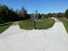 In there middle you can see a Pro Dunk Gold Basketball System on side of the forked concrete driveway.