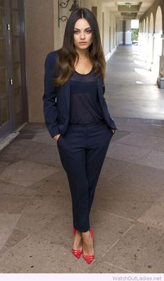 Awesome navy suit with red high heels