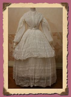 Period Garment: Sheer white muslin with a double sleeve.