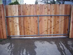 1000 images about wood fence gate ideas on pinterest for Building a sliding gate for a driveway