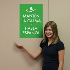 California Middle School Spanish Teacher In A Classroom Decorated ...