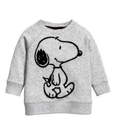 Soft sweatshirt with a printed motif at front. Long raglan sleeves, snap fasteners at back of neck, and ribbing at neckline, cuffs, and hem.