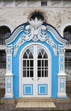 Exterior of a vestibule in Russia. Sky blue with amazingly ornate trim painted white. Would look totally out of place on my house but I still want it..... #home #design