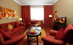 Living Room:Beautiful Red Fabric Accent Sofa Set And Glas Coffee Table Also Red Velvet Arm Sofa With Round Wood End Table And Soft Yellow Area Rug And White Red Curtains Red Living Room Amazing Red Living Room Design Ideas Red Living Room Decor, Home Decor Bedroom, Interior Design Living Room, Living Room Furniture, Living Room Designs, Sofa Furniture, Interior Paint, Furniture Design, Chic Retro