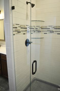 Subway tile and an accent stripe between two glass shelves. Simple and elegant! - House of Carpets