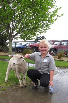 Fernridge school pupil Emily Smith with Rosie the lamb. Emily was one of 22 children who took part in the Foster a Lamb programme Town And Country, Country Living, New Zealand, The Fosters, Sheep, Lamb, Bring It On, Pets, School