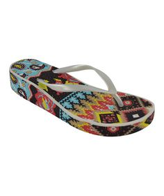 c8f412256df Take a look at this Ivory Boho Patchwork Wedge Flip-Flop by MUK LUKS on