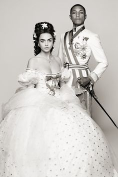 "Cara Delevingne and Pharrell Williams in costume for ""Reincarnation"" by Karl Lagerfeld. [Photo by Karl Lagerfeld]"