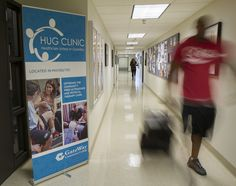 Student walks past the HUG Clinic at GateWay Community College.