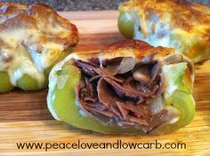 Philly Cheesesteak Stuffed Peppers: thin-sliced roast beef, sliced provolone cheese, green bell peppers, sweet onion, baby bella mushrooms, butter, olive oil, minced garlic, salt, and pepper.