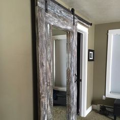 I made this beautiful DIY beachy farmhouse barn door with full length mirror from my own plan and homemade stain. Cost was approximately $200 including the barn door hardware kit which we bought on Amazon.com.