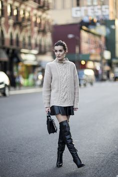 Chunky sweater, leather skirt and thigh-high boots