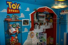 Disney Room, These are pictures of my step-daughters bedroom and play room that were 100% designed and built by her father. Both rooms are connected by a child size door with a castle on the bedroom side and Mickeys house on the play room side. For more photos check out http://youtu.be/japtqJN8O04, This is the Toy Story themed wall of the play room, it has functional closet space for clothing and toys while still remaining 100% Disney.  , Girls Rooms Design