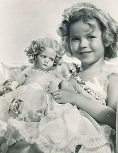 Shirley Temple and her Lenci doll, 1934.