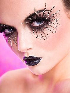 I just love stuff around the eye like this.  I bet it takes a long time.  I am seriously going to do this for Halloween.  Maybe not this exact one, but some glitter and jewels around the eyes for sure. ^^