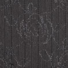"""Black looped threads form delicate stripes across this charcoal gray rose embroidered polyester suiting. Of a medium weight and with its chic appearance, the possibilities are endless. A beautifully embroidered floral design along its soft surface provides a nice textural and relaxing essence adding to the fashionable flare it already possesses. With a crisper drape, this embroidered suiting is a delight for adventures pursued with style. Laying at 59"""" in width, create beautiful tunics, ..."""