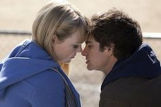 The Amazing Spider-Man 'The Kiss' Photo with Emma Stone and Andrew Garfield - Peter Parker and Gwen Stacy share an intimate moment in the high school bleachers from Marc Webb's upcoming Marvel romance.