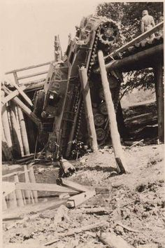 A Panzer 4 immobilized after a bridge collapse.