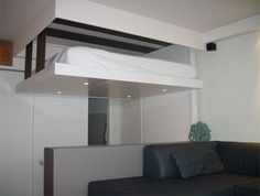 In a bid to one-up the traditional fold-up Murphy bed, two companies are switching a wall-based storage approach for a ceiling-centric alternative. Description from weburbanist.com. I searched for this on bing.com/images