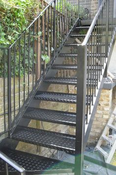 Exterior wooden stair designs brick design front steps outside stairs for house back porch door ideas Staircase Outdoor, Staircase Handrail, Iron Staircase, Railings, Steel Stairs Design, Metal Stairs, Staircase Design, Metal Deck, Garden Stairs