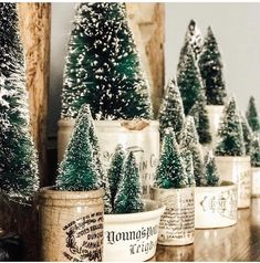 Add in some bottle brush trees into your advertising pots to creative a fun and non traditional holiday vignette. Christmas Mood, Merry Little Christmas, Country Christmas, Vintage Christmas, Christmas Crafts, Christmas Decorations, Xmas, Christmas Ideas, Christmas Stuff