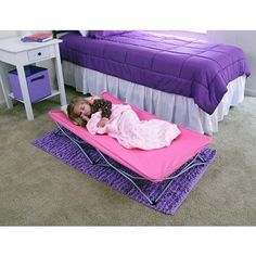 The My Cot Pink Portable Travel Bed with Travel Bag is a child-sized portable sleeping cot that is perfect for sleepovers, camping, grandma's house, dayc. Portable Toddler Bed, Toddler Cot, Toddler Travel, Portable Bed, Toddler Camping, Sleeping Mats For Kids, Girl Sleeping, Bed Liner, Extra Bed