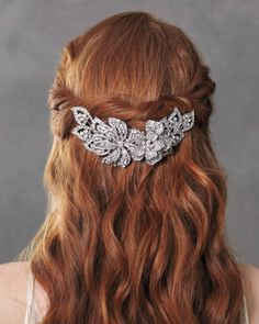 A gorgeous half-up, half-down style is held in place with a big, beautiful clip.
