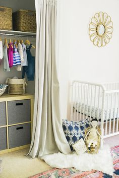 White nursery with adorable and colorful closet