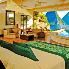 Sitting majestically above the beach resort of Anse Chastanet, Jade Mountain, St Lucia is an incredible creation. Each uniquely designed sanctuary suite is reached by an individual bridge and features 15ft high ceilings and just 3 walls - the 4th removed entirely to be open to the spectacular views. The bedrooms, living area and extravagant private pools blend perfectly to create a simply jawdropping experience