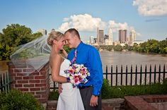 Bride and Groom at Boat House at Confluence Park with Columbus skyline.  #columbusweddingphotographer #boathouse #chillicotheweddingphotographer